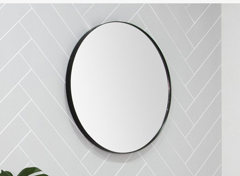 Introducing the Alora wall mirror. With its striking matte black metal frame